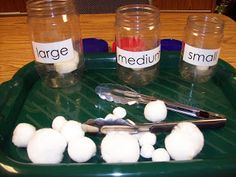 This is a good sorting game. There are clearly three sizes and they get vocabulary by looking at the jar labels.