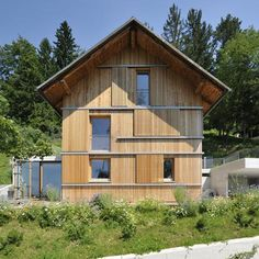 Slovenian architects Kombinat have transformed a gloomy Alpine chalet into a contemporary home with concrete wings and timber shutters like a sliding puzzle Wooden Hut, Wooden Facade, Modern Barn House, New Staircase, Wooden Terrace, Brick Architecture, Weekend House, Pole Barn Homes, House Roof