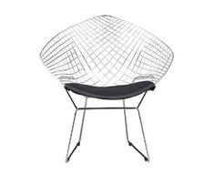 Based on Harry Bertoia iconic 1950's metal chair, the Black net chair cradles and contours your back. The welded framework is made of solid steel and includes a black leatherette cushion which wraps around the chair front for leg comfort. Rent the Black net chair for extra seating in the living room or dining room.  <br><br>