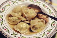 My mom's vegan tofu dumplings recipe filled with savory sesame tofu, cooked in shiitake broth. By Juhea Kim