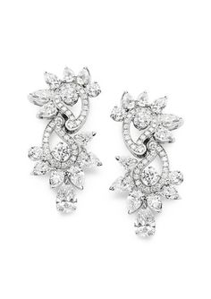 Piaget Earrings in 18K white gold set with 22 pear-shaped diamonds and 84 brilliant-cut diamonds.