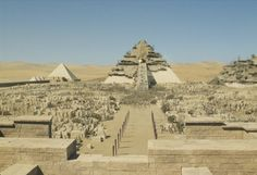 The new site will exist on the lands drained by the Nile river, and which, many centuries later, will be known as Egypt. Because the lands are flat and no natural features exist to be used as landing guidepoints, the Anunnaki create two 'peaks' by constructing four sided, pyramid-shaped structures. They are designed by NINGISHZIDDA. The largest of the two structures is given the name of Ekur (i.e. House Which Like A Mountain Is).