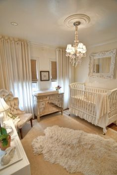 Ceiling to floor wall of curtains & antique mirror over crib, love the beige and off white and gold. Might be my favorite of all gender neutrals