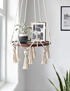 Mkono-Hanging-Shelf-Macrame-Plant-Hanger-Flower-Pot-Holder-Boho-Home-Decor-with-Wood-PlateYou can find Plant hangers and more on our website.Mkono-Hanging-Shelf-Macrame-Plant-Hanger-Flower-Pot-Holder-Boho-Home-Decor-with-Wood-Plate Decoration Hall, Decoration Photo, Decoration Christmas, Decoration Bedroom, Decoration Design, Hanging Decorations, Diy Hanging Shelves, Hanging Table, Hanging Plants