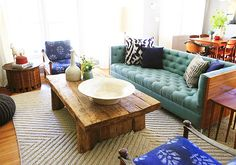 designed by Emily Henderson.The contrast done by the play of textures, from the ikat fabric to the teal tufted sofa and the roughness of the wooden coffee table. Turquoise Sofa, Living Room Turquoise, Turquoise Accents, Eclectic Living Room, Home Living Room, Living Spaces, Living Area, Living Room Inspiration, Home Decor Inspiration