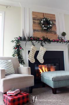 Christmas Decorating- love this rustic mantle with touches of pink
