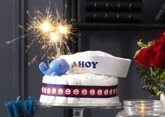 Ahoy Baby diaper cake. Single-tiered diaper cake with 100 HUGGIES® Pure &…