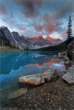 Moraine Lake is located in the Valley of the Ten Peaks at an elevation of 1885 m (6184 ft). The ten peaks tower 1200 to 1500 m (4900 ft) above the lake building a continuous ridge of 12 km (7.5 miles) length.