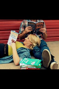 Pregnancy announcement with parenting books ... love this!