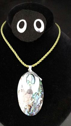 Silver pendant with abulon shell  and earings. From Taxco Guerrero.  Raquel Martinez Chavez