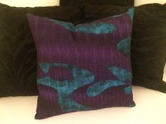 The luscious purples and teals of Randonnee 06 as a cushion cover.  I'm looking at plusher fabrics to try this on as a throw!