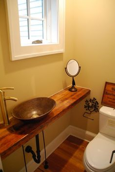 half bathroom ideas - Want a half bathroom that will impress your guests when entertaining? Update your bathroom decor in no time with these affordable, cute half bathroom ideas. Tiny Half Bath, Small Half Bathrooms, Small Half Baths, Amazing Bathrooms, Small Bathroom, Bathroom Faucets, Bathroom Mirrors, Tiny Bath, Bathroom Storage