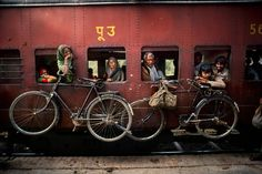 Bicycles hanging on the side of a train, West Bengal, India, Photographer: Steve McCurry Steve Mccurry, West Bengal, Smartphone Fotografie, Vivre A New York, World Press Photo, Afghan Girl, Digital Photography School, Photo Composition, Photography Composition