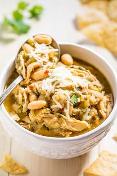 Yum (minus the beans)! Easy Homemade White Chicken Chili - Hearty, healthy, loaded with tender chicken, and packed with bold flavor! Fast and easy comfort food that everyone loves! It'll be on rotation all winter! Chili Recipes, Soup Recipes, Chicken Recipes, Cooking Recipes, Healthy Recipes, Healthy Chili, Healthy Soups, Simple Recipes, Dinner Recipes