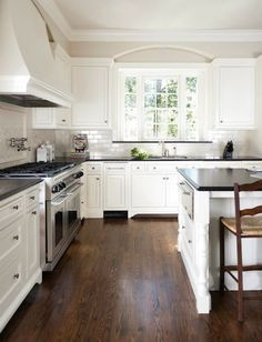 Love the dark wood, white cabinets, and grey tile. A little color in the crown moulding might make everything pop though!