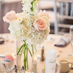 Rose and Hydrangea Centerpieces   white hydrangeas   blush pink roses   white snapdragon and clear cylinder vase