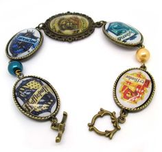 Essentials Harry Potter Hogwarts Four College Badges Bracelet Harry Potter Bracelet, Harry Potter Jewelry, Hogwarts Crest, Harry Potter Hogwarts, Hogwarts Houses, Mischief Managed, Geek Chic, Geek Stuff, Fashion Jewelry