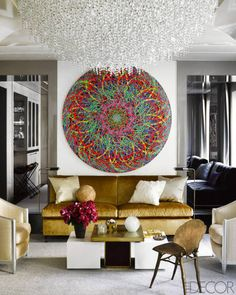 I love this room-In the living room, a painting by Ryan McGinness hangs above a custom-made banquette covered in a Pollack velvet.
