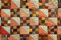 HS Triangles in peach & white with scrappy brown/red/gold 9-patches.  Kalona Quilt Show & Sale