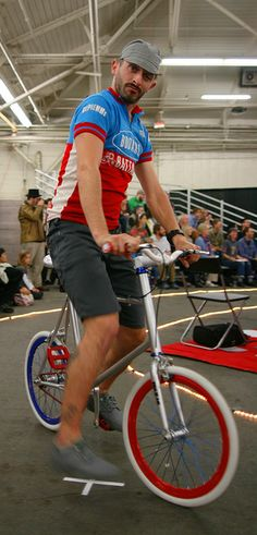 On a Mixed Gear minivelo bike.    Pedal Savvy bike fashion show at 2011 SF Bike Expo November 12 2011 at the San Francisco Cow Palace.