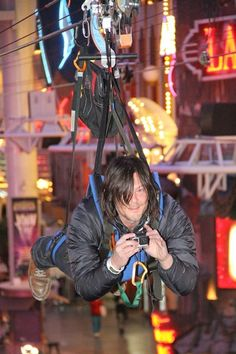 Norman Reedus (Daryl Dixon) rides the SlotZilla zip line in downtown Las Vegas.