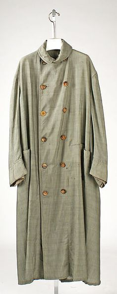 Duster ca. 1905, Culture: American, Medium: mohair, cotton. Dusters were worn as protective clothing during the early 1900's. Cars were completely open air during this time period. In order to protect finer textiles, dusters were necessary. These large overcoats often had a collar that could be unbuttoned and pulled up to protect the next. Some even had detachable motoring veils to protect the face from dust and other hazards.