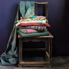 stack of throws on wooden chair