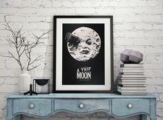 Looking for a conversation-starting piece of decor or that perfect gift item? Our A Trip to the Moon print will do the trick! An original giclée print that faithfully captures the wonder and charm of the vintage classic silent movie. This print will surely make a stunning addition