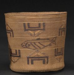 A Tlingit polychrome basket  Centering a panel with depictions of salmon between twin bands of alternating house-form motifs.  height 7in, 7 3/4in
