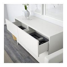"""IKEA - BESTÅ, Storage combination w doors/drawers, white/Valviken dark brown, drawer runner, soft-closing, 47 1/4x15 3/4x29 1/8 """", , The drawers and doors close silently and softly, thanks to the integrated soft-closing function.The legs raise your BESTÅ combination from the floor, giving it a light airy look and making it easy to clean the floor underneath.Two drawers make it easy to keep your belongings organized. The shelves behind the doors give you even more storage space."""