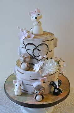 This cake was done for a friend. The woodland animals are made out of fondant.