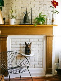 Even a nonworking fireplace adds character. Mix a group of plants and blooms together on your mantel for a lively, artful display.