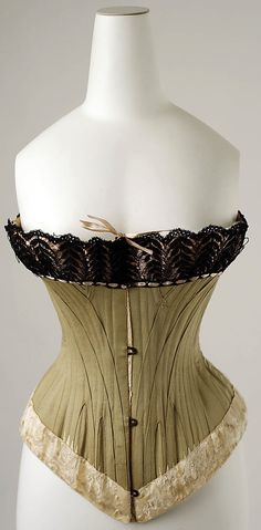 Corset Date: ca. 1893 Culture: American Medium: cotton, silk Dimensions: Length at CB: 13 in. (33 cm) Credit Line: Gift of Mrs. Earl Rowe, 1951 Accession Number: C.I.51.15.19