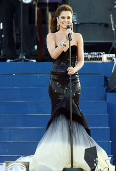 cheryl cole performing on stage in fishtail sequin black and white gown