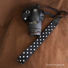 This camera strap used fabric for front side, and for back side, use leather (same camera cases piping color).    SHOKO MIYAMOTO camera strap is