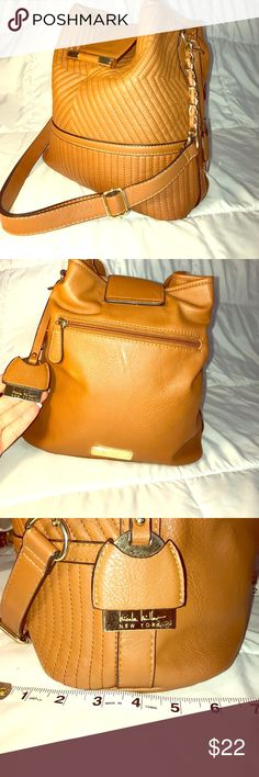 ✨Nicole Miller bucket style handbag✨ This is a great 👜 handbag. Bucket style with 3 inside pockets, one larger with a zip, two smaller for cards and cell phone. Has gold hardware and all chains and clasps are in tact. This has been very gently used and has been taken care of. Faux leather and a great design equal style! Lmk if you have a reasonable offer and I'll accept! Nicole Miller Bags Shoulder Bags
