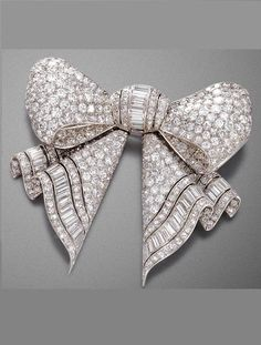 cool Circa 1920 brooch designed as a ribbon bow, pavé set throughout with diamonds a...