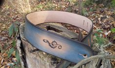 Leather Guitar strap with treble clef and music notes in turquoise, natural, and dk brown on Etsy, $65.00