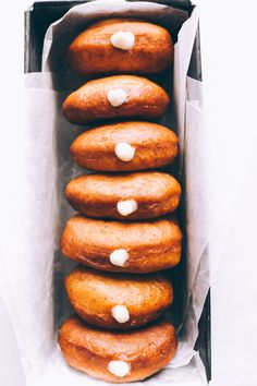 Vegan Boston Cream Doughnuts - These are generously filled with creamy vanilla custard and coated in a thick layer of dairy free chocolate making them a snack must have! NeuroticMommy.com #vegan #bostoncream