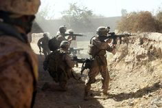 U.S. Marines with India Company, 3rd Battalion, 5th Marine Regiment provide covering fire for fellow Marines as they move out of a danger area after taking sniper fire during a security patrol in Sangin, Afghanistan, on Nov. 2, 2010. The battalion is one of the combat elements of Regimental Combat Team 2, whose mission is to conduct counterinsurgency operations in partnership with the International Security Assistance Force.