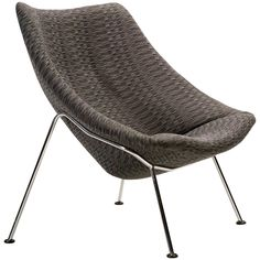Large version of the Oyster lounge chair designed by Pierre Paulin for Artifort.The slim lines of the chrome base give this large chair a light appearance.It was given new foam and reupholstered in a fabric with typical pattern six years ago.