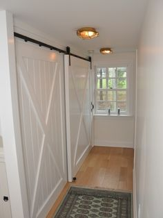 traditional hall hall closet design using barn door style