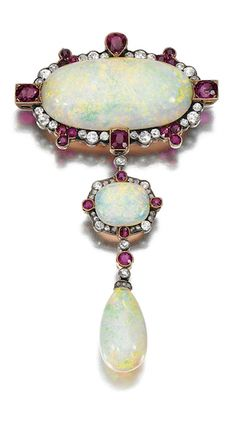 BROOCH/PENDANT, EARLY 20TH CENTURY Centring on an oval opal within a surround millegrain-set with circular-cut diamonds and variously shaped rubies, suspending a similarly set opal terminating on an opal drop, WM Bruford Son Ltd.