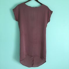 """Dusty Rose Tunic Dusty rose loose-fit tunic. High-low hem. Front round neckline with V-back and black elastic strap details. Approx. 27"""" shoulder to front hem length. 100% polyester. Gently worn. lola Tops Tunics"""