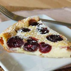 Cherry Custard Clafouti This traditional country French dessert is made by topping a layer of fruit with batter. After baking this dessert is sometimes served hot with cream. Cherry Desserts, Cherry Recipes, French Desserts, Köstliche Desserts, Delicious Desserts, Dessert Recipes, Yummy Food, French Food, Clafoutis Recipes