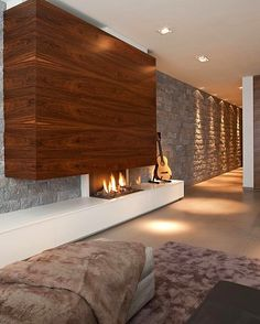 I love this modern stiled house interior with this guitar, led lights and fireplace. Home Fireplace, Fireplace Design, Fireplace Modern, Contemporary Interior Design, Modern Design, Design Moderne, Interior Architecture, Living Spaces, Living Rooms
