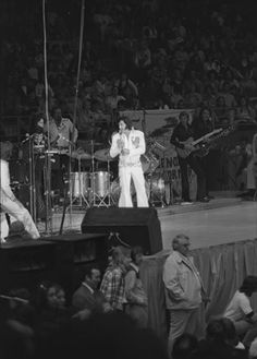 """Billy Stanley: """"I never got to see Elvis perform, when we were on the road... I was too busy watching out for the fans who would rush the stage... That's me kneeling in front of the stage... I could always tell when he would walk up behind me though, because the women would come running... One time I looked over my shoulder at Elvis, and he was smiling... I think he did it just to get me..."""""""