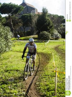 Competitor taking part in a cyclo cross competition in Acquedotti in Cinecitta park, Rome, Italy.