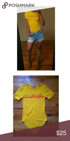 Brand New Zara Yellow Bodysuit T-Shirt -Zara Yellow Bodysuit T-Shirt -New With Tags  -Written: Eye Contact -Thin t-shirt -Strecthy  -Best worn with a jeans, shorts, skirts -No stains or spots -Fast shipping: Same day or next day depending on when purchased. Zara Tops Tees - Short Sleeve