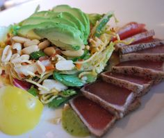 Sashimi Tuna Salad with seared rare ahi tuna, avocado, amorosa tomatoes,   fresh mint, peanuts and crispy noodles with a chili lime dressing